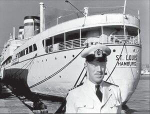 Captain Gustav Schroeder in front of the SS St. Louis.  The German sailor attempted to save 937 Jews on his ship by finding them refuge after being refused entry to Cuba, the United States and Canada.  For his actions, he was recognized by Yad Vashem as a Righteous Gentile.